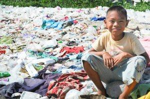 Thailand-boy-sitting-on-trash